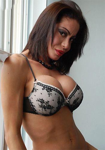 Brazilian Shemale Nicole plays with her big Cock